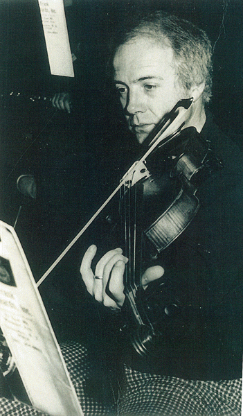 Don Mildrum '53 plays viola at an orchestra rehearsal
