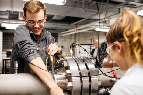 students adjusting bolts on pressure tube