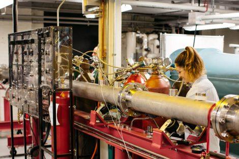 student working on pressure tube