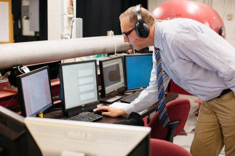 professor examining data on computer screen